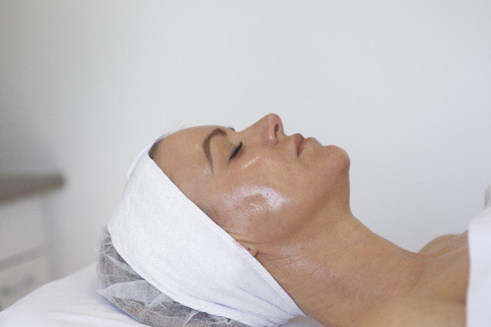 clinical peel woman in beauty clinic relaxing